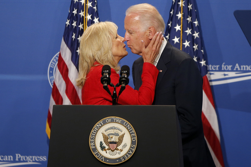 Jill Biden kisses her husband, Vice President Joe Biden, as she introduces him at The White House Summit on Working Families, Monday, June 23, 2014, in Washington. The gathering, organized by the White House, Labor Department, and the Center for American Progress, highlights the challenges and offers solutions faced by working families in America. (AP Photo/Charles Dharapak)