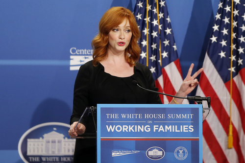 """Actress Christina Hendricks, known for her role in the television series """"Mad Men"""", speaks at The White House Summit on Working Families, Monday, June 23, 2014, in Washington. The gathering, organized by the White House, Department of Labor, and the Center for American Progress, highlights the challenges and offers solutions faced by working families in America. (AP Photo/Charles Dharapak)"""