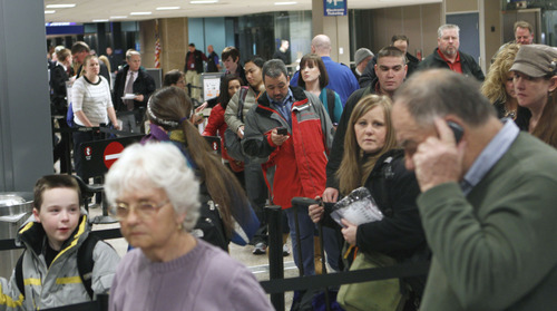 Tribune file photo by Al Hartmann  | This was a familiar scene this past year at Salt Lake City International Airport-- fliers lining up to go through a security checkpoint -- as FAA data showed almost a 1 percent increase in traffic through the airport last year.