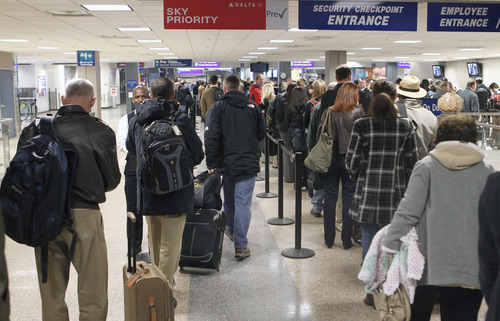 Tribune file photo by Al Hartmann  | This was a frequent scene last year at Salt Lake City International Airport -- fliers lining up to go through security -- as FAA data showed the airport had almost a 1 percent increase in passenger.