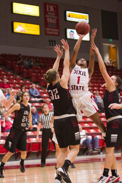 (File photo) Dixie's Miranda Moore fights with the Azusa Pacific University defense while playing on Saturday January 11, 2014