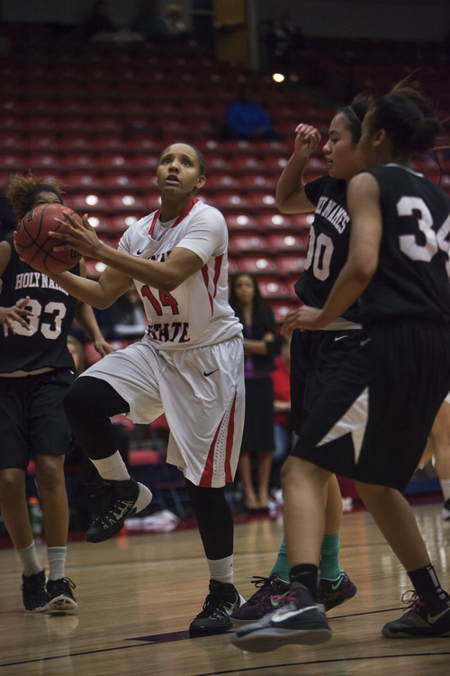 (File photo) Dixie State's Austen Harris takes a shot against Holy Names' Sonia Aguilar at Dixie State High on Saturday, Feb. 8, 2014.