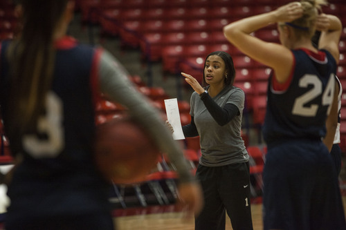 (Trevor Christensen  |  The Spectrum & Daily News) Dixie State Women's Basketball Coach Catherria Turner gives players instruction during a practice at the Burns Arena on Wednesday, November 6, 2013.