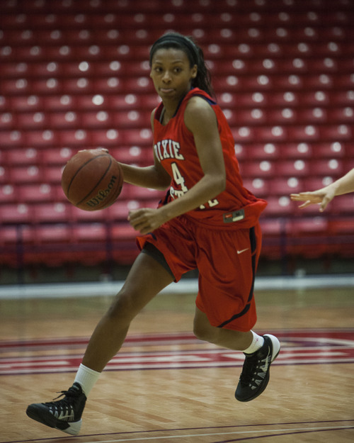 (File photo) Nanea Woods dribbles the ball during a Dixie State scrimmage game at the Burns Arena on Tuesday, October 22, 2013.