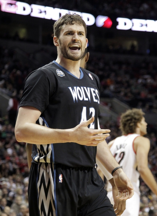 Minnesota Timberwolves forward Kevin Love complains after he is called for a foul during the first half of an NBA basketball game against the Portland Trail Blazers, Saturday, Jan. 25, 2014, in Portland, Ore. (AP Photo/Don Ryan)
