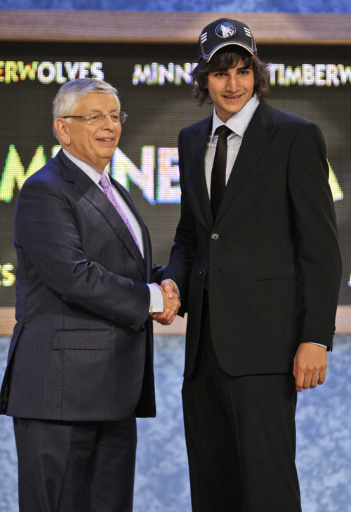 FILE -- This is a june 25, 2009, file photo showing NBA commissioner David Stern, left, posing with Ricky Rubio, of Spain, after being picked fifth overall by the Minnesota Timberwolves during the first round of the NBA basketball draft, in New York. Timberwolves president David Kahn says Spanish point guard Ricky Rubio has backed out of a deal to play in Minnesota this season. Kahn says the Wolves negotiated a deal on Saturday night with Rubio's Spanish pro team and agent Dan Fegan to bring the 18-year-old to Minnesota this fall.  But Rubio informed Kahn on Monday night,  Aug. 31, 2009,  that he would prefer to stay in his homeland for two more years to better prepare himself for the NBA.  (AP Photo/Frank Franklin II, File)
