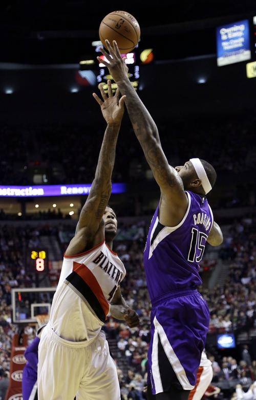 Sacramento Kings center DeMarcus Cousins, right, and Portland Trail Blazers forward Thomas Robinson battle for a rebound during the first half of an NBA basketball game in Portland, Ore., Wednesday, April 9, 2014. (AP Photo/Don Ryan)
