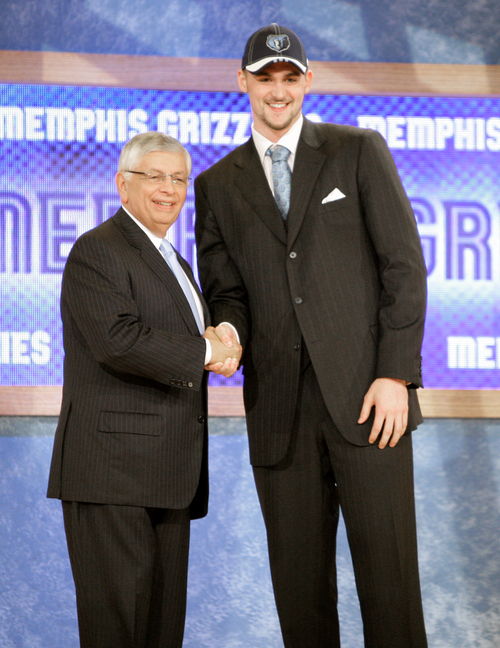 UCLA's Kevin Love, right, is congratulated by David Stern after being picked 5th overall by the Memphis Grizzlies during the first round of the NBA basketball draft, Thursday, June 26, 2008 in New York. (AP Photo/Julie Jacobson)