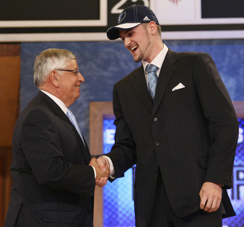 Kevin Love, right, is congratulated by NBA commissioner David Stern after being picked fifth overall by the Memphis Grizzlies during the first round of the NBA basketball draft, Thursday, June 26, 2008, in New York. (AP Photo/Seth Wenig)
