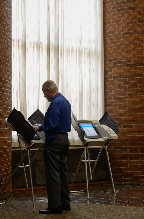 Francisco Kjolseth  |  The Salt Lake Tribune Orem residents cast their votes in primary elections at the Government offices on Tuesday, June 24, 2014.