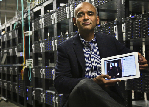 FILE - This Dec. 20, 2012 file photo shows Chet Kanojia, founder and CEO of Aereo, Inc., holding a tablet displaying his company's technology, in New York.  The Supreme Court has ruled that a startup Internet company has to pay broadcasters when it takes television programs from the airwaves and allows subscribers to watch them on smartphones and other portable devices. The justices said Wednesday by a 6-3 vote that Aereo Inc. is violating the broadcasters' copyrights by taking the signals for free. The ruling preserves the ability of the television networks to collect huge fees from cable and satellite systems that transmit their programming. (AP Photo/Bebeto Matthews, File)