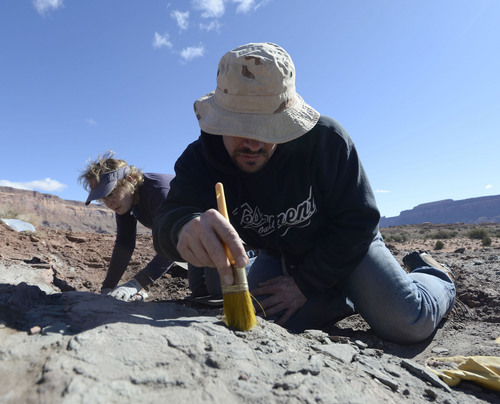 Al Hartmann  |  The Salt Lake Tribune  Natural History Museum of Utah volunteers Jeanettte Bonnell and Erin Finney carefully remove overburden with brushes looking for fossils of fish at a promising site near Canyonlands National Park.