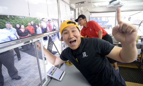 Al Hartmann  |  The Salt Lake Tribune Cupbop owner Jung Hun Song yells out orders for Korean barbecue during the weekly food truck rally at the Gallivan Center Thursday June 19.