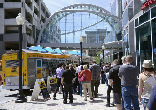 Al Hartmann  |  The Salt Lake Tribune Folks queue up to order at the Chow Truck and Gravy Train Poutinerie at the weekly food truck rally at the Gallivan Center Thursday June 19.