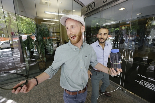 Plaintiffs Derek Kitchen, left, and his partner, Moudi Sbeity, one of three couples who brought a lawsuit against Utah's gay marriage ban, celebrate as they arrive at their lawyer's office in Salt Lake City on Wednesday, June 25, 2014. A federal appeals court on Wednesday ruled for the first time that states must allow gay couples to marry, finding the Constitution protects same-sex relationships and putting a remarkable legal winning streak across the country one step closer to the U.S. Supreme Court. (AP Photo/Rick Bowmer)