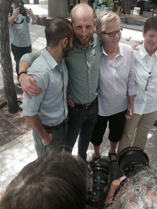(Scot Sommerdorf   The Salt Lake Tribune)  Plaintiffs, including Moudi Sbeity, left and Derek Kitchen, gather at a press conference to celebrate the 10th Circuit Court's ruling on same-sex marriage on June 25, 2014.