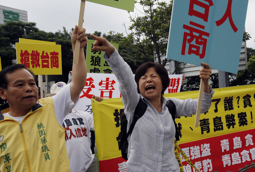Anti-China demonstrators protest the arrival of Zhang Zhijun, minister of Beijing's Taiwan Affairs Office at the airport hotel after his arrival in Taoyuan, Taiwan, Wednesday, June 25, 2014. China has sent Zhang, its first ever ministerial-level official to Taiwan for four days of meetings to rebuild ties with the self-ruled island that Beijing claims as its own, after mass protests in Taipei set back relations earlier this year. (AP Photo/Wally Santana)