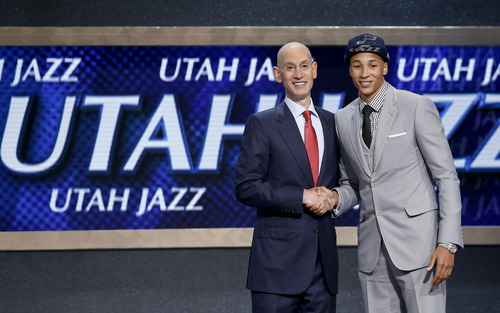 Dante Exum, right, poses for a photo with NBA Commissioner Adam Silver after being selected by the Utah Jazz as the fifth overall pick during the 2014 NBA draft, Thursday, June 26, 2014, in New York. (AP Photo/Kathy Willens)