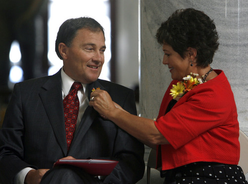 Salt Lake City -  Utah Lt. Governor Gary Herbert gets a little help with his boutonnière from his wife Jeanette Herbert during the Centenarian Celebration at the State Capitol  Friday Jun 26, 2009.  Steve Griffin/The Salt Lake Tribune 6/26/09