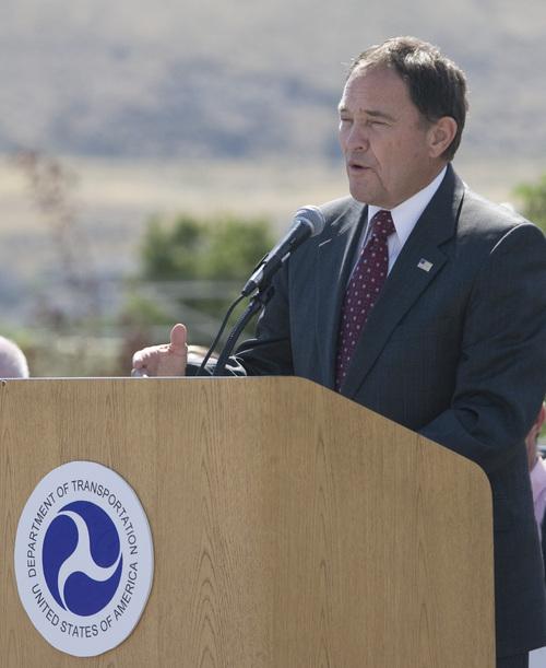 Rick Egan  | The Salt Lake Tribune   Gov. Gary Herbert speaks at the grand opening ceremonies for the new Draper TRAX line.Friday, August 16, 2013.