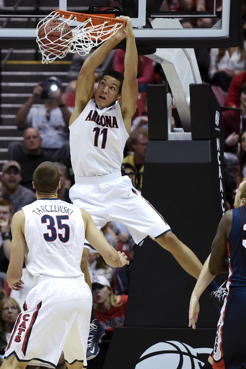 FILE - In this March 23, 2014 file photo, Arizona forward Aaron Gordon dunks a basket against Gonzaga during the first half of a third-round game in the NCAA college basketball tournament in San Diego. Gordon is a possible pick in the 2014 NBA Draft, Thursday, June 26, 2014 in New York. (AP Photo/Denis Poroy)