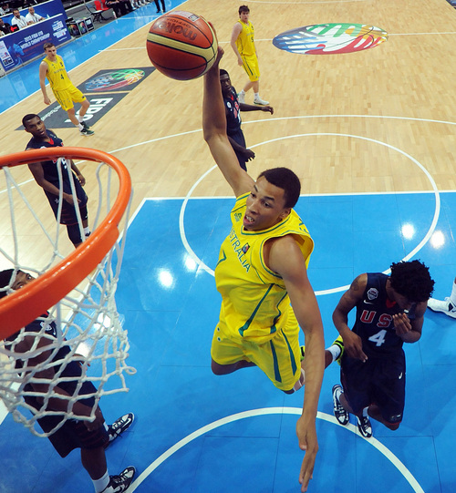 This July 2, 2013 photo provided by FIBA shows Australian basketball player Dante Exum going to the basket during a match between Australia and the United States at the FIBA U19 championships in Prague. Exum is a possible pick in the 2014 NBA Draft, Thursday, June 26, 2014 in New York. (AP Photo/FIBA)
