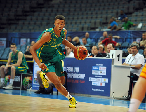 This June 29, 2013 photo provided by FIBA shows Australian basketball player Dante Exum during the FIBA U19 championship match against Brazil in Prague. Exum is a possible pick in the 2014 NBA Draft, Thursday, June 26, 2014 in New York.(AP Photo/FIBA)