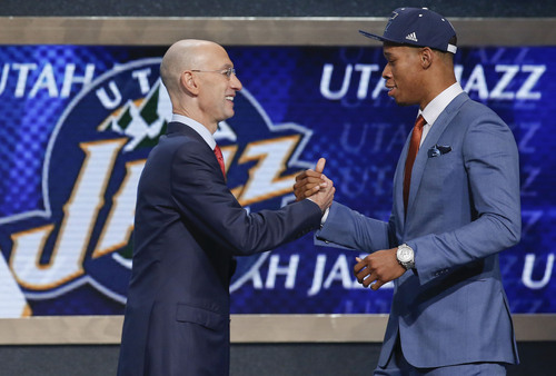 Duke guard Rodney Hood, right, is greeted by NBA Commissioner Adam Silver after being selected 24th overall by the Utah Jazz during the 2014 NBA draft, Thursday, June 26, 2014, in New York. (AP Photo/Kathy Willens)