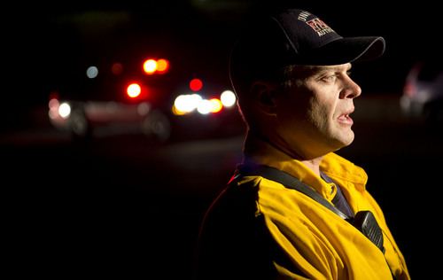 Jeremy Harmon  |  The Salt Lake Tribune  Unified Fire Battalion Chief Brian Anderton talks about a fire as it burns just south of RioTinto's smelter near Magna in the early morning hours of June 26, 2014. 55 firefighters were working to contain the blaze.
