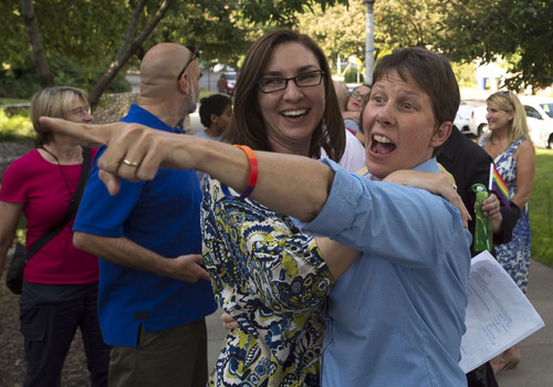 Steve Griffin  |  The Salt Lake Tribune   Plaintiff Kody Partridge smiles and points to a friend as she joined Utah Unites for Marriage at City Creek Park in Salt Lake City, Utah Wednesday, June 25, 2014, to celebrate the historic decision in Kitchen v. Herbert and stepping-stone toward the freedom to marry.