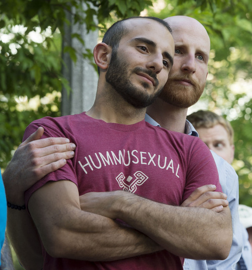 Steve Griffin  |  The Salt Lake Tribune   Plaintiffs Moudi Sbeity and Derek Kitchen listen to speakers as they joined Utah Unites for Marriage at City Creek Park in Salt Lake City, Utah Wednesday, June 25, 2014, to celebrate the historic decision in Kitchen v. Herbert and stepping-stone toward the freedom to marry.