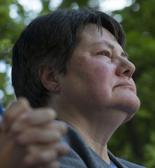 Steve Griffin  |  The Salt Lake Tribune   Plaintiff Kate Call listens to speakers as she joined Utah Unites for Marriage at City Creek Park in Salt Lake City, Utah Wednesday, June 25, 2014, to celebrate the historic decision in Kitchen v. Herbert and stepping-stone toward the freedom to marry.