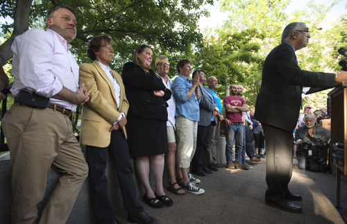 Steve Griffin  |  The Salt Lake Tribune   Attorney's and plaintiffs listen to Salt Lake County District Attorney Sim Gill as they join Utah Unites for Marriage at City Creek Park in Salt Lake City, Utah Wednesday, June 25, 2014, to celebrate the historic decision in Kitchen v. Herbert and stepping-stone toward the freedom to marry.