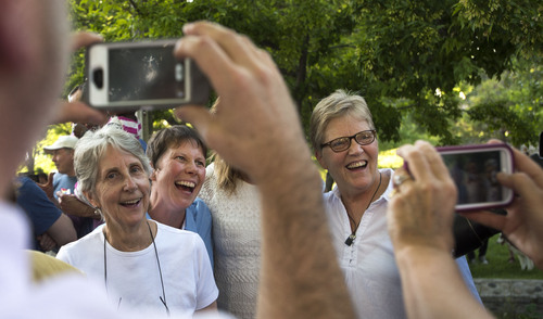 Steve Griffin  |  The Salt Lake Tribune   Plaintiffs Kody Partridge, second from left, and Laurie Wood, right, stand for photographs as they join Utah Unites for Marriage at City Creek Park in Salt Lake City, Utah Wednesday, June 25, 2014, to celebrate the historic decision in Kitchen v. Herbert and stepping-stone toward the freedom to marry.