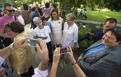 Steve Griffin  |  The Salt Lake Tribune   Attorney's and plaintiffs stand for photographs as they join Utah Unites for Marriage at City Creek Park in Salt Lake City, Utah Wednesday, June 25, 2014, to celebrate the historic decision in Kitchen v. Herbert and stepping-stone toward the freedom to marry.