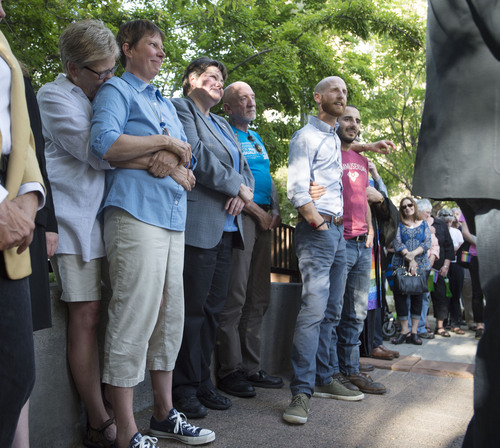 Steve Griffin  |  The Salt Lake Tribune   Plaintiffs Laurie Wood and Kody Partridge, left, Kate Call, third from left, (Karen Archer did not attend) and Derek Kitchen and Moudi Sbeity, right, join Utah Unites for Marriage at City Creek Park in Salt Lake City, Utah Wednesday, June 25, 2014, to celebrate the historic decision in Kitchen v. Herbert and stepping-stone toward the freedom to marry.