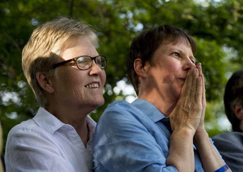 Steve Griffin  |  The Salt Lake Tribune   Plaintiffs Laurie Wood and Kody Partridge listen to speakers as they join Utah Unites for Marriage at City Creek Park in Salt Lake City, Utah Wednesday, June 25, 2014, to celebrate the historic decision in Kitchen v. Herbert and stepping-stone toward the freedom to marry.