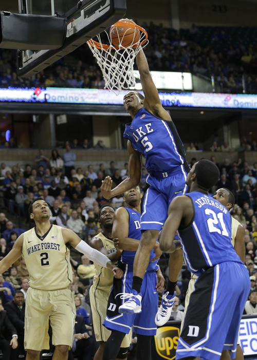 Duke's Rodney Hood (5) tries to dunk against Wake Forest during the second half of an NCAA college basketball game in Winston-Salem, N.C., Wednesday, March 5, 2014. Wake Forest won 82-72. (AP Photo/Chuck Burton)
