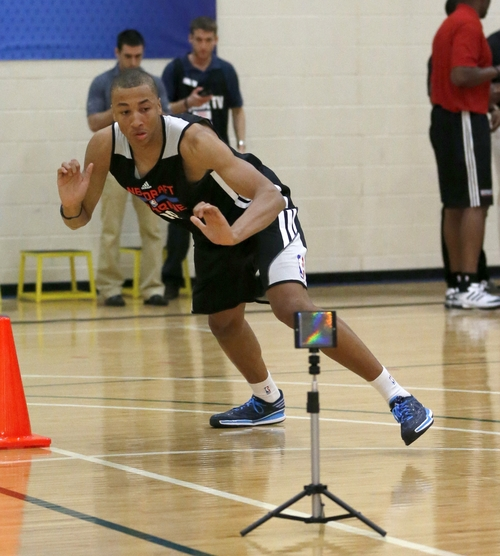 Dante Exum, from Australia, participates in the lane agility course in the 2014 NBA basketball draft combine Friday, May 16, 2014, in Chicago. (AP Photo/Charles Rex Arbogast)