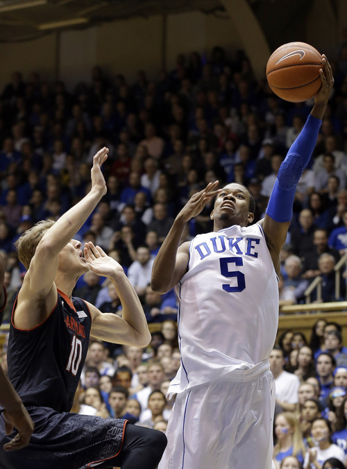 Duke's Rodney Hood (5) shoots as Maryland's Jake Layman (10) defends during the first half of an NCAA college basketball game in Durham, N.C., Saturday, Feb. 15, 2014. (AP Photo/Gerry Broome)
