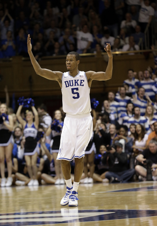 Duke's Rodney Hood (5) reacts following a basket against North Carolina during the second half of an NCAA college basketball game in Durham, N.C., Saturday, March 8, 2014. Duke won 93-81. (AP Photo/Gerry Broome)