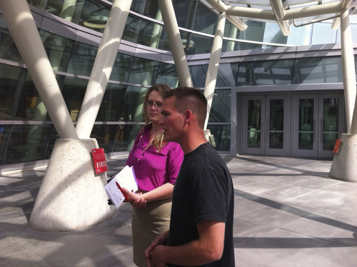 Sean Kendall, whose dog Geist was shot and killed by a Police officer on June 18, 2014, addresses reporters outside police headquarters in Salt Lake City.