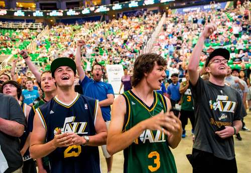 Trent Nelson  |  The Salt Lake Tribune Utah Jazz fans Dylan Halverson, Talmage Flitton and Alex Flitton react in celebration as the Utah Jazz select Dante Exum in the NBA Draft, at a fan party at EnergySolutions Arena in Salt Lake City, Thursday June 26, 2014.