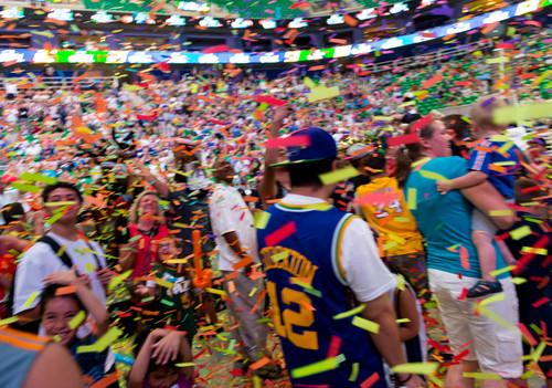 Trent Nelson  |  The Salt Lake Tribune Fans at EnergySolutions Arena react in celebration as the Utah Jazz select Dante Exum in the NBA Draft in Salt Lake City, Thursday June 26, 2014.