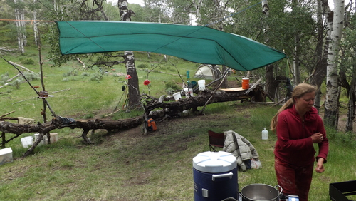 """(David Self Newlin   The Salt Lake Tribune)  Raphael Cordray, a member of the Utah Tar Sands Resistance at the kitchen area of camp. The group is camping at PR Springs in what they call a permanent """"protest vigil"""" in an effort to stop development of tar sands in the area."""