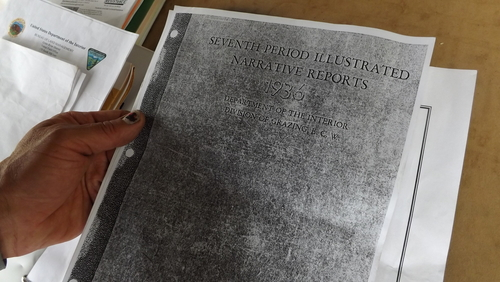 """(David Self Newlin   The Salt Lake Tribune)  Lionel Trepanier looks over a copy of a1936 report about the site now called PR Springs which he says shows that the department of the interior found groundwater on the site. Utah Tar Sands Resistance is camping at PR Springs in what they call a permanent """"protest vigil"""" in an effort to stop development of tar sands in the area."""