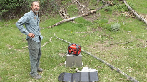 """(David Self Newlin   The Salt Lake Tribune)  Lionel Trepanier next to a portable power source charged using solar power. Utah Tar Sands Resistance is camping at PR Springs in what they call a permanent """"protest vigil"""" in an effort to stop development of tar sands in the area."""