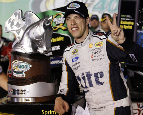 Brad Keselowski poses with the trophy after winning the NASCAR Sprint Cup series auto race Saturday, June 28, 2014, at Kentucky Speedway in Sparta, Ky. (AP Photo/James Crisp)