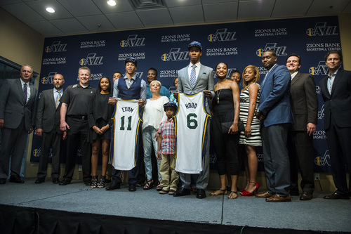 Chris Detrick  |  The Salt Lake Tribune Utah Jazz's Dante Exum and Rodney Hood pose for pictures with members of their family during a press conference at the Zions Bank Basketball Center Friday June 27, 2014.