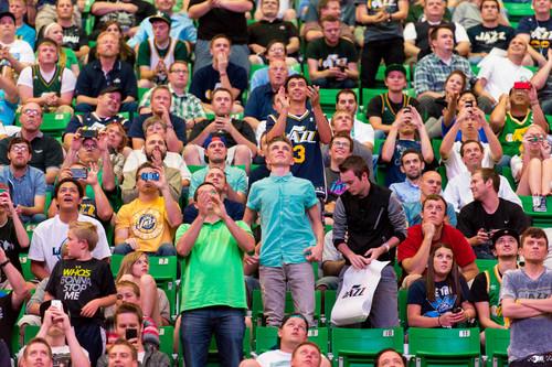 Fans at EnergySolutions Arena in Salt Lake City react as he Utah Jazz selected Dante Exum, of Australia, in the NBA basketball draft, Thursday, June 26, 2014. (AP Photo/The Salt Lake Tribune, Trent Nelson)